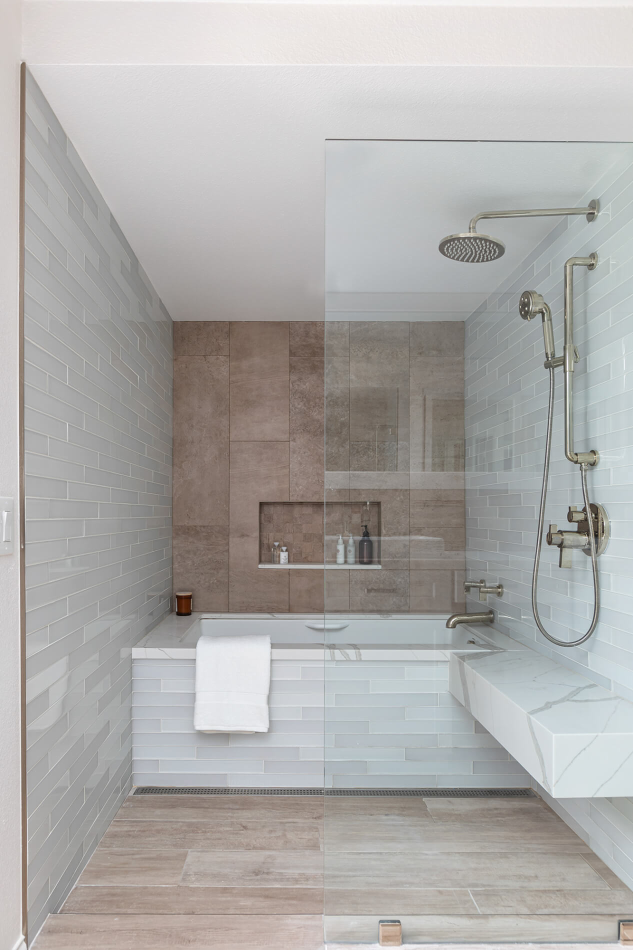 a walk-in shower with a tub
