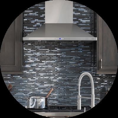 Blue metallic backsplash makes big splash in kitchen remodel.