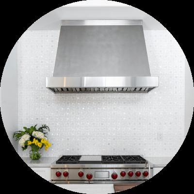 Textured stone kitchen backsplash