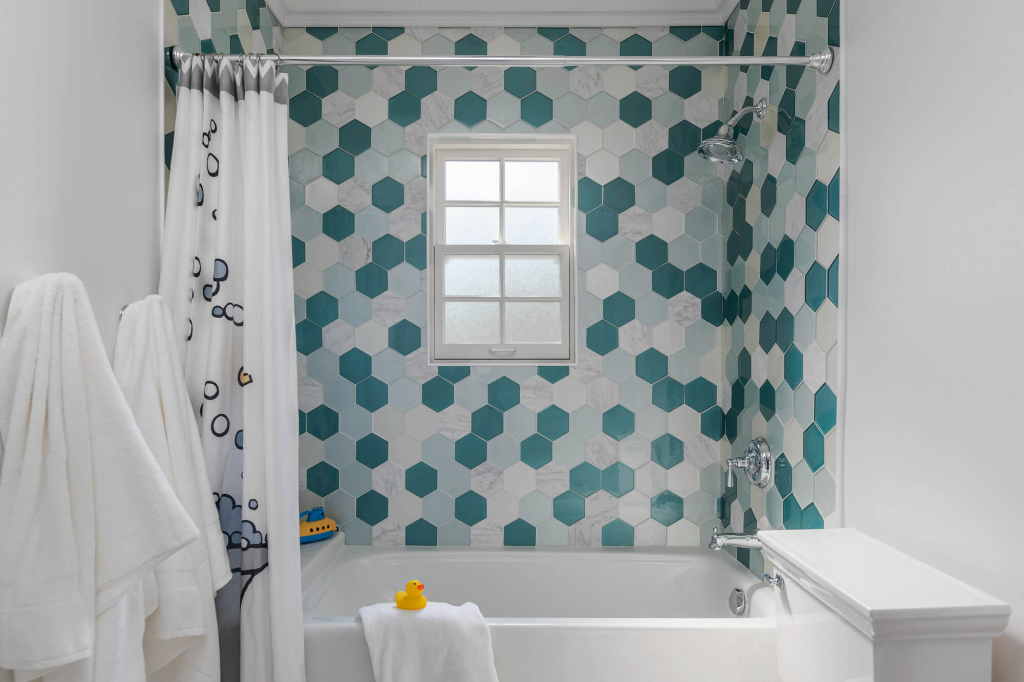 Bathroom with blue and white hexagon tile