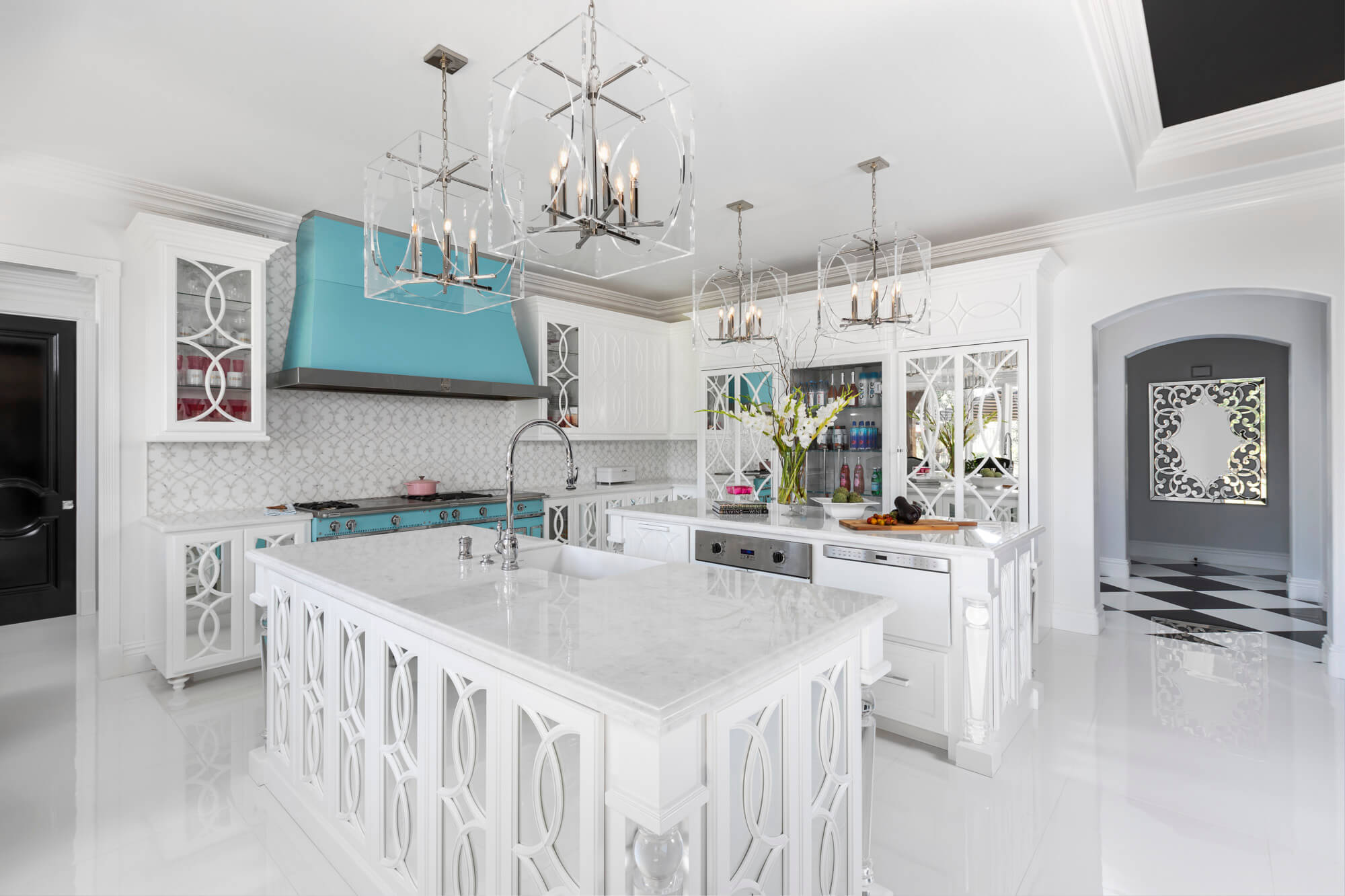 White kitchen with ornate cabinets