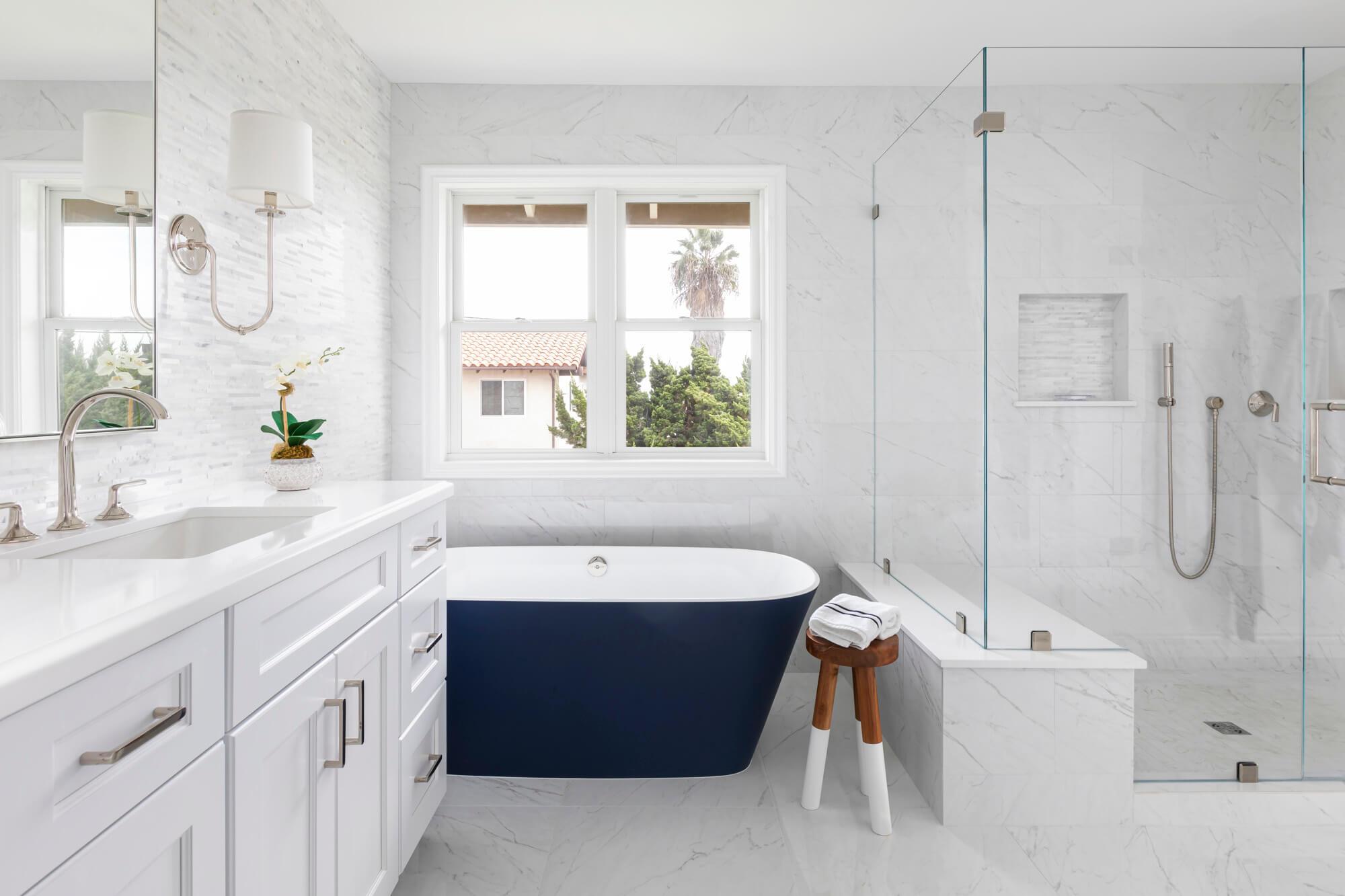 White bathroom with blue tub