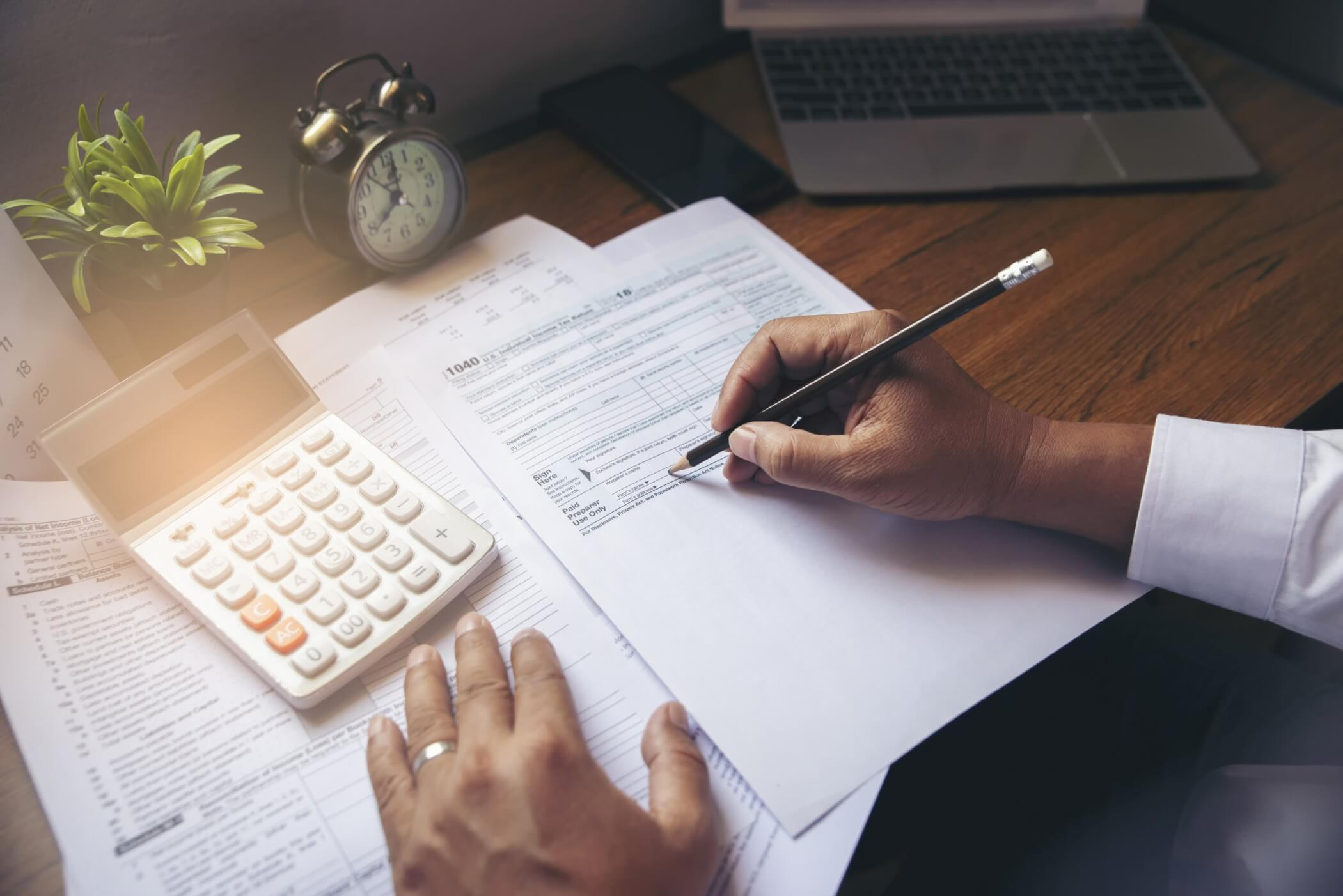 Man doing taxes in home office