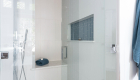 Blue-glass-accent-in-shower-nook-in-Rancho-Santa-Margarita-bathroom-remodel