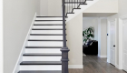 Transitional-black-and-white-stairway-design-in-whole-home-remodel