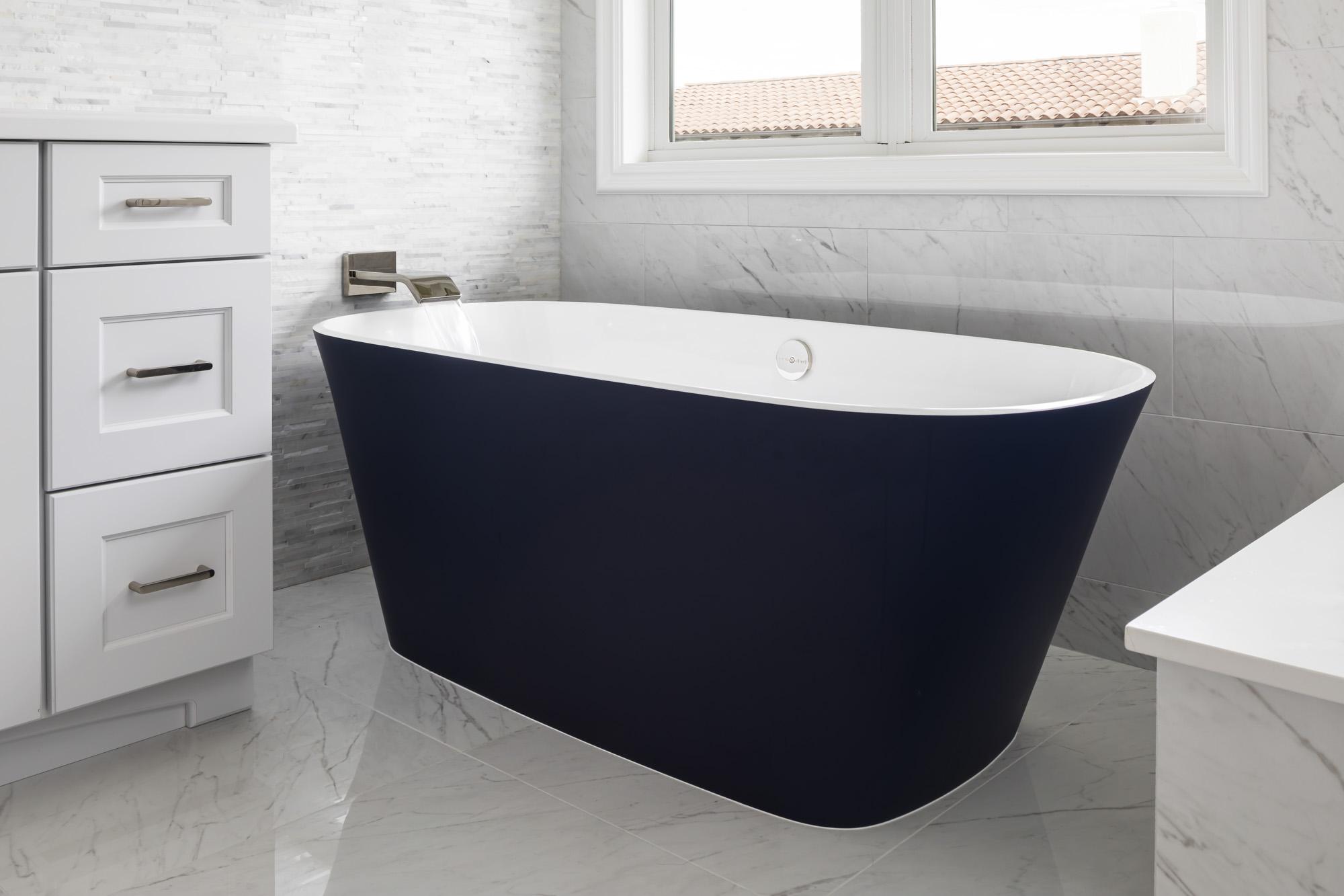 Bold-color-tub-in-white-bathroom-remodel