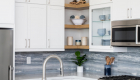 Kitchen-island-remodel-with-sink-allows-more-inclusive-prepping-space