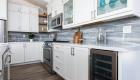 Kitchen-renovation-with-beverage-center-under-quartz-countertop-along-perimeter