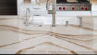 Bold-warm-quartz-countertop-with-gold-thick-veins-in-kitchen-remodel