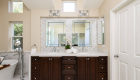 Dual-vanity-sinks-with-marble-mosaic-tile-backsplash