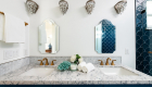 Master-bathroom-quartz-stone-countertops-with-custom-blue-painted-cabinetry-in-bathroom-remodel