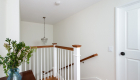 New-opened-landing-above-stairway-design-in-home-renovation