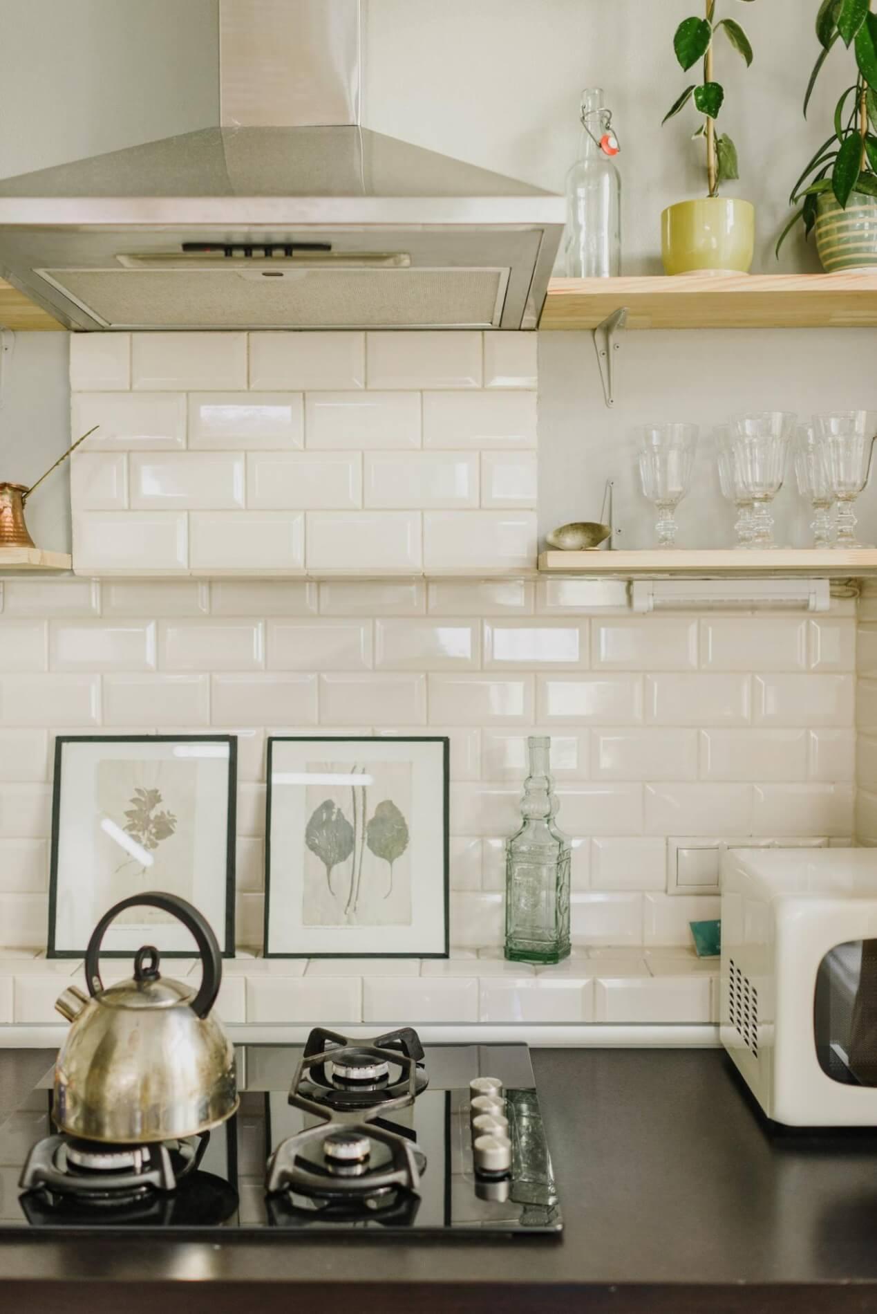 Solid countertop with tile backsplash