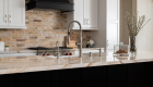 Transitional-moody-kitchen-design-with-custom-decorative-hood-in-Laguna-Hills-Remodel