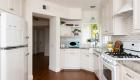 kitchen-remodel-with-antique-inspired-tile-backsplash-and-retro-kitchen-appliances