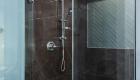 Walk-in-shower-with-glass-herringbone-accent