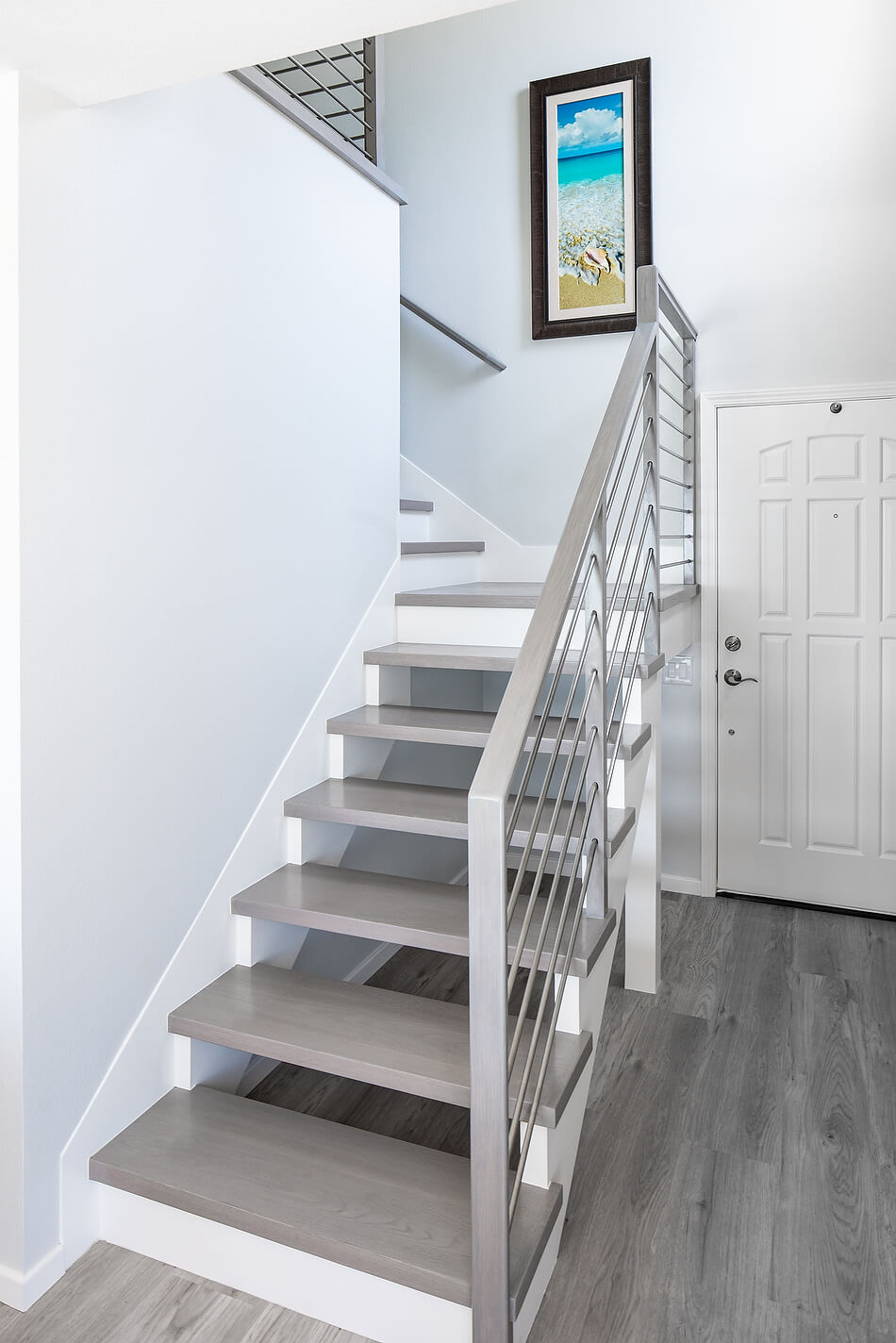 ascending white staircase with light grey treads