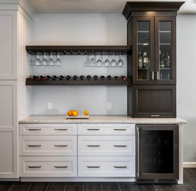 Butler's pantry with wooden wall wine storage, wine fridge, and cabinets.