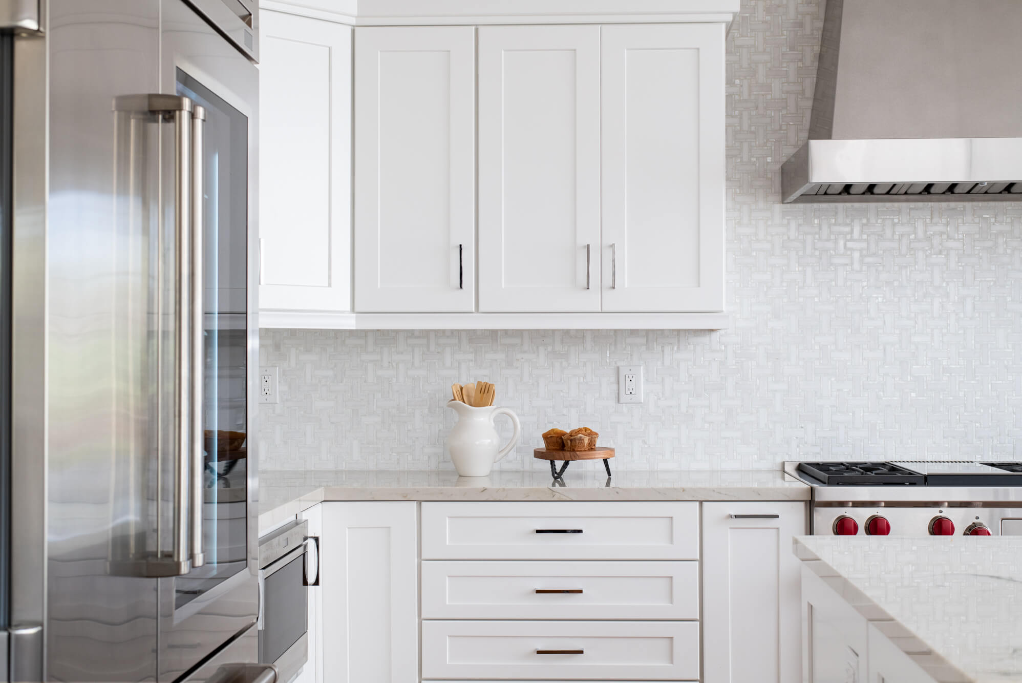 white-Irvine-kitchen-remodel-with-marble-backsplash-tile