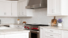 white-kitchen-remodel-with-stainless-steel-appliances