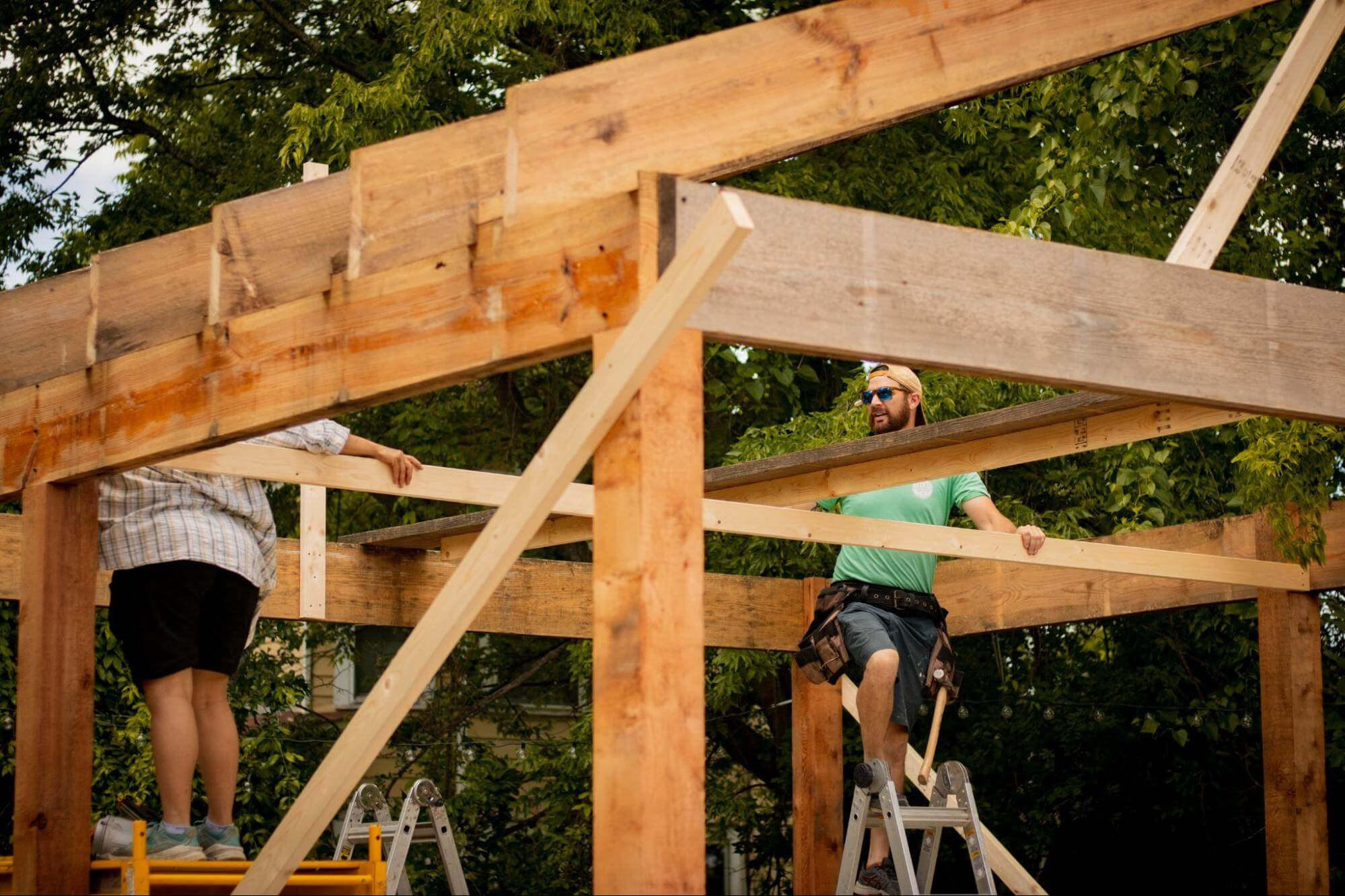 people working on building a home