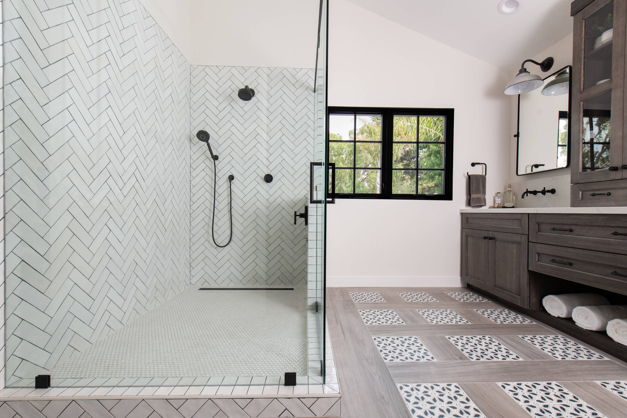 Bathroom Renovation With Herringbone Pattern Shower Tile and Patterned Floor Insets