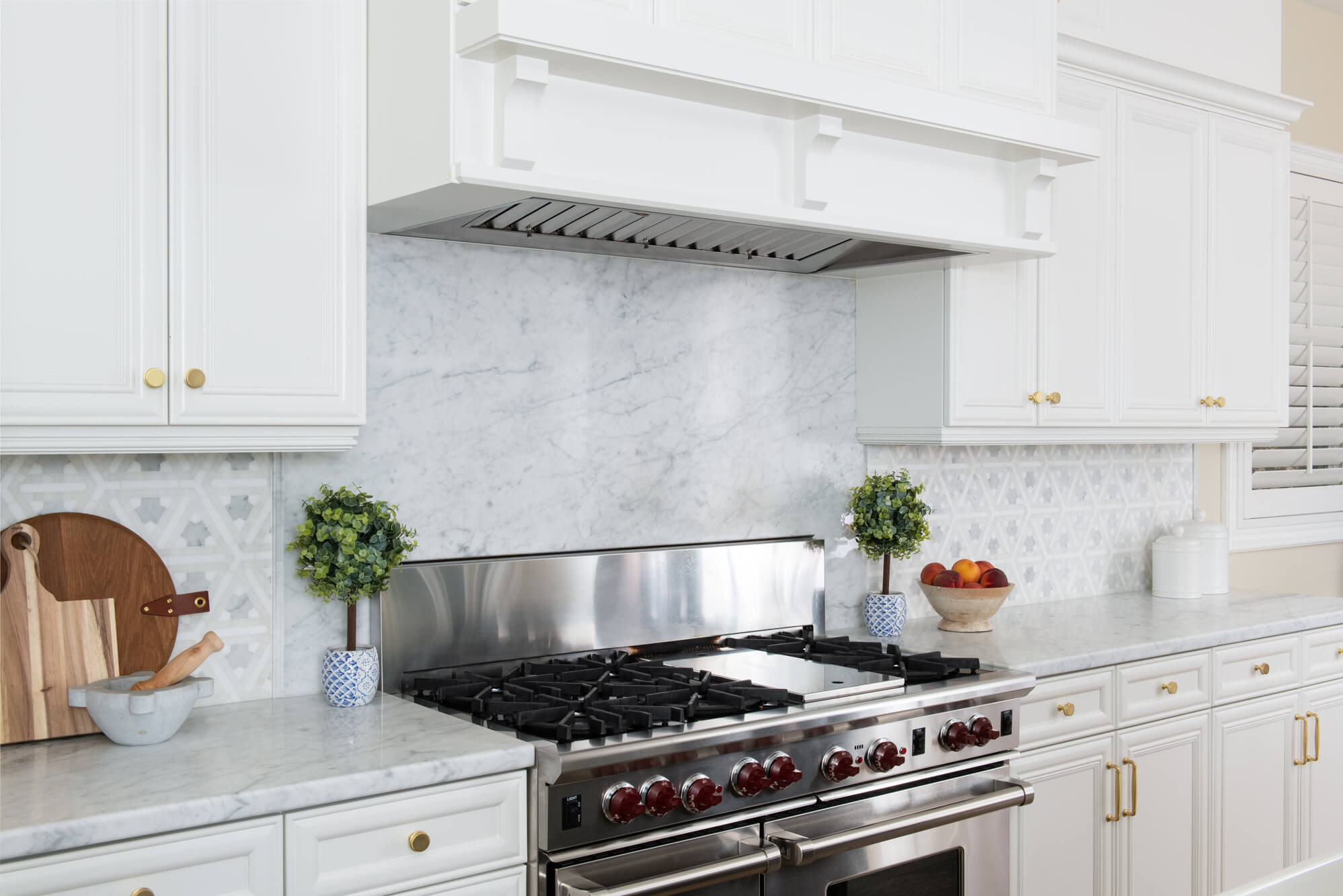 Geometric Marble Backsplash in Kitchen Remodel With Accent