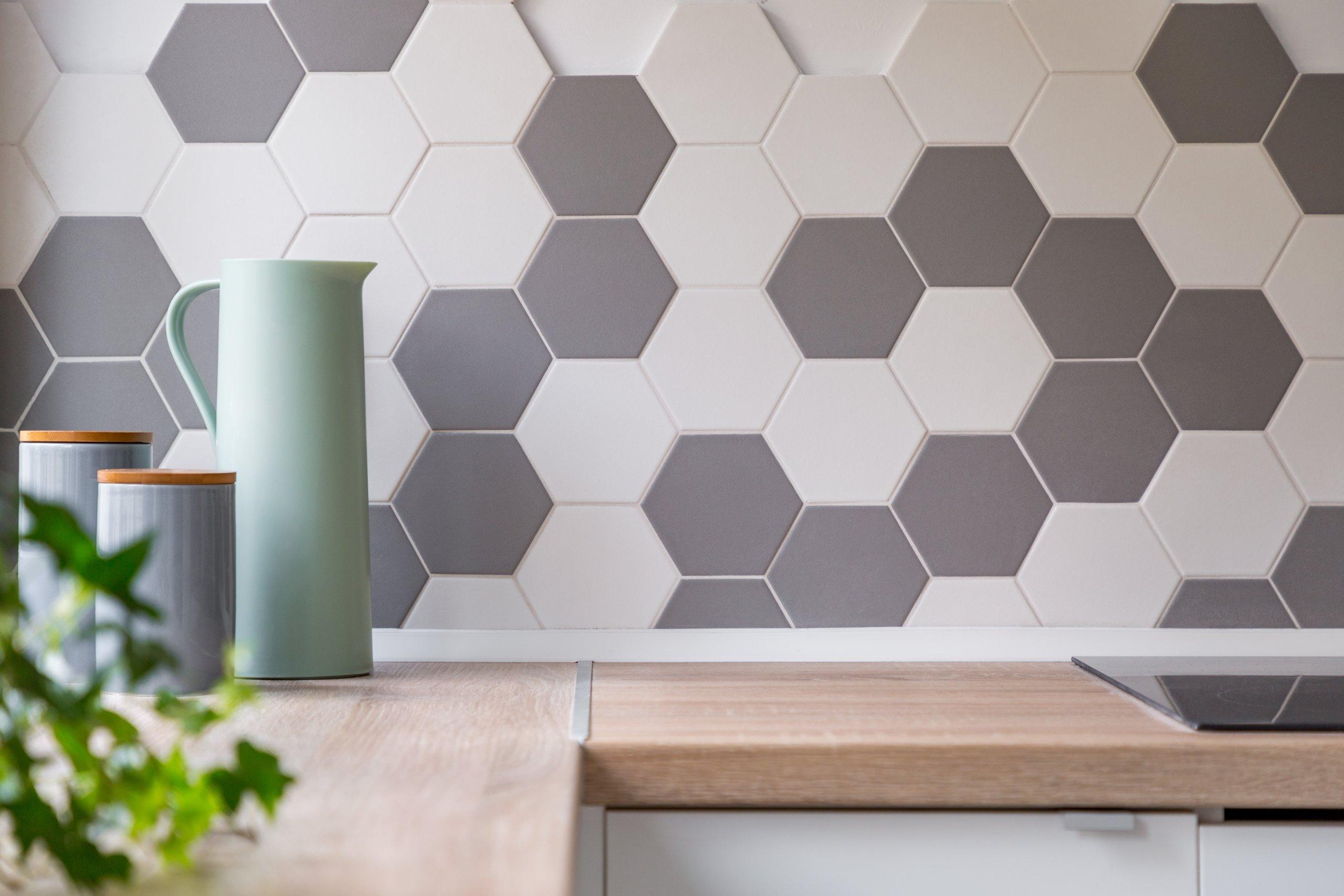 Grey and white hexagon kitchen backsplash